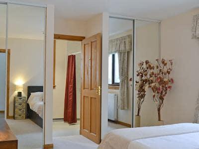 Dressing area and entrance to en-suite | Glen View, Balnain near Drumnadrochit