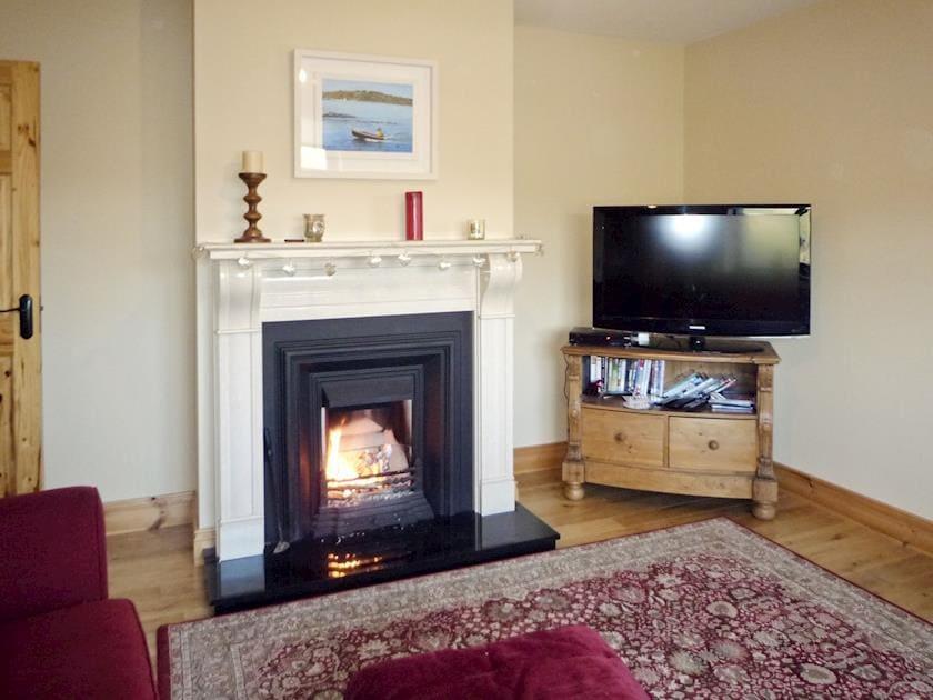 Cosy living room with open fire | Ti' Una Seaview, Lettermore