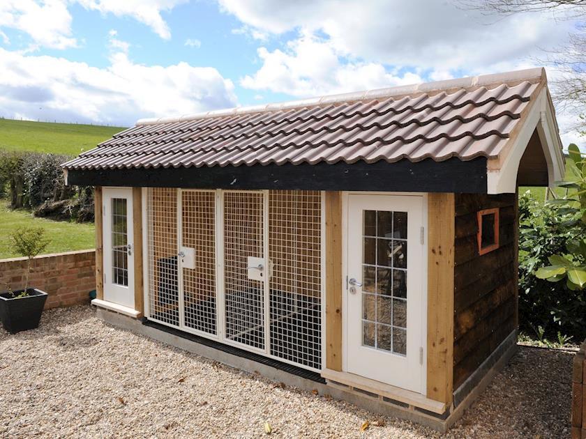 Heated dog kennels on patio at rear of property   Lambley Lodge, Lowdham