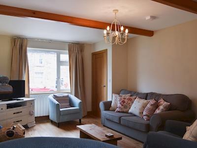 Stylish lounge area with wood burner | Bluebell Cottage, Burton in Lonsdale, near Ingleton