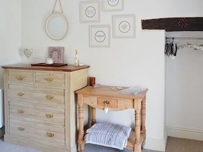 Dressing area in bedroom | L'al Cottage, Sockbridge, near Penrith