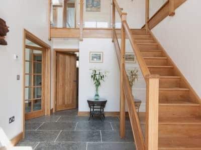 Grand hallway with feature oak staircase | Blackdown Farm, Manor Barn, Blackawton, nr. Dartmouth