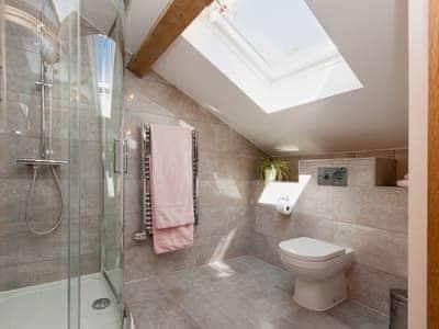 Fully-tiled en-suite shower room | Blackdown Farm, Manor Barn, Blackawton, nr. Dartmouth