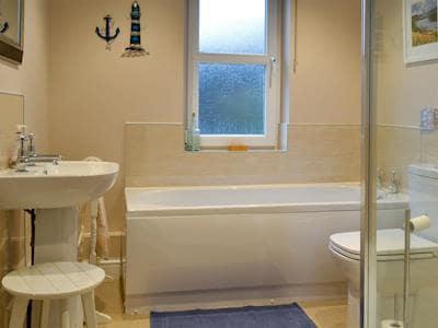 Family bathroom with shower over bath | Ullscroft, Keswick