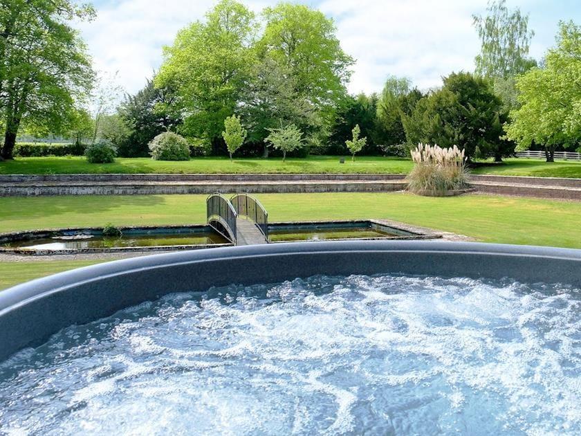 Hot tub in beautiful garden | Summer House, St Asaph