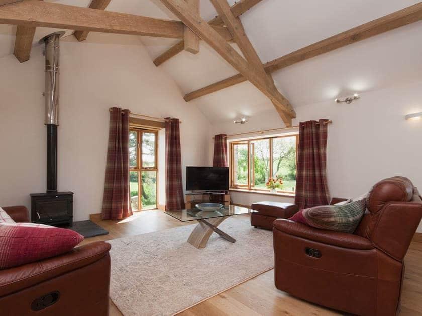 living room with vaulted ceiling | Blackdown Farm, Manor Barn, Blackawton, nr. Dartmouth