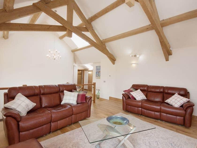 Beamed ceiling and wooden floors in the living room | Blackdown Farm, Manor Barn, Blackawton, nr. Dartmouth
