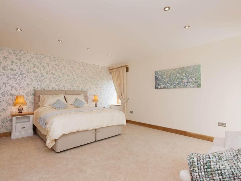 Master bedroom with luxurious furnishings | Blackdown Farm, Manor Barn, Blackawton, nr. Dartmouth