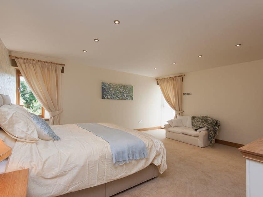 Stylishly decorated and furnished master bedroom | Blackdown Farm, Manor Barn, Blackawton, nr. Dartmouth