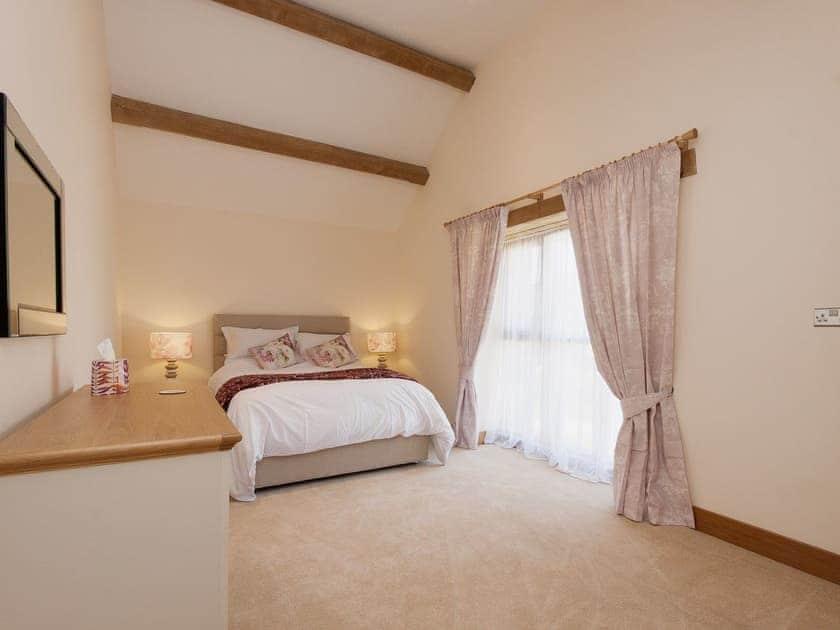 Lofty beamed ceiling in the double bedroom | Blackdown Farm, Manor Barn, Blackawton, nr. Dartmouth