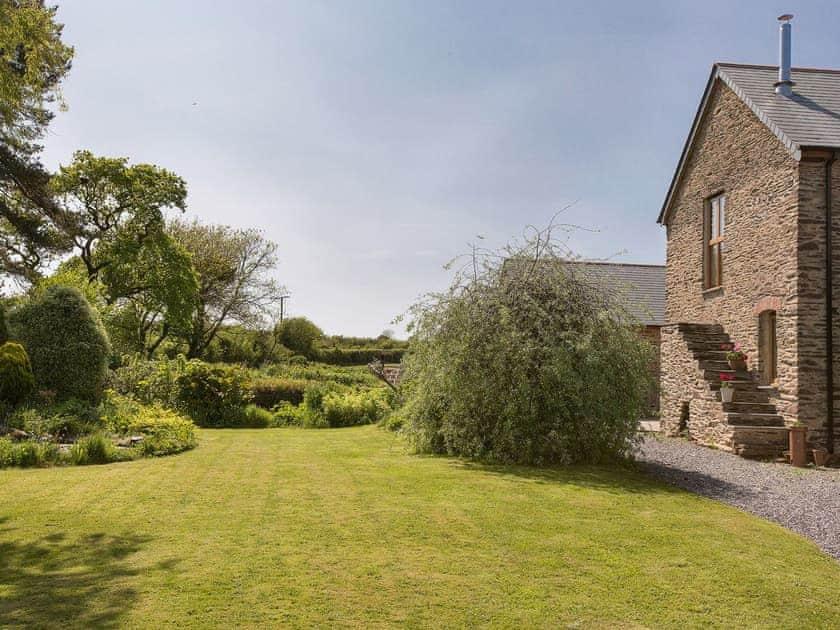 The cottage is set in manicured gardens | Blackdown Farm, Manor Barn, Blackawton, nr. Dartmouth