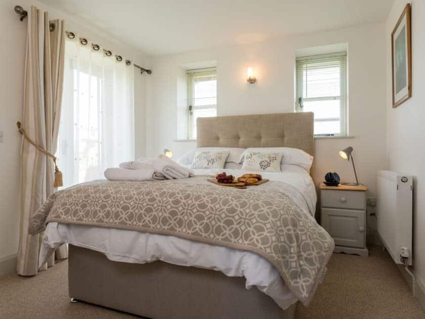 Stylish double bedroom with kingsize bed and en-suite bathroom | The Rocket House, Hartland Quay, near Hartland, Bideford