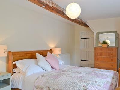 Double bedroom | Upper Woodhouse Farm, Rhos-Y-Meirch, near Knighton