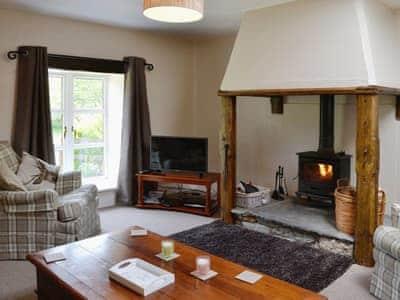 Charming living room with wood burner   Woodside Cottage, Nether Bellandy, Glenrinnes, near Keith