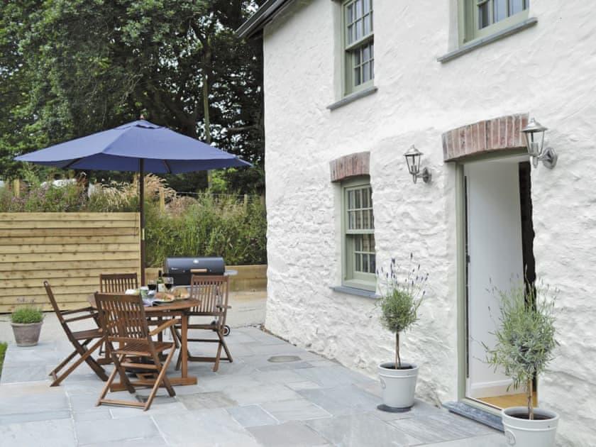 Relaxing patio area - ideal for al fresco dining | Lavender Cottage, Kea, near Truro