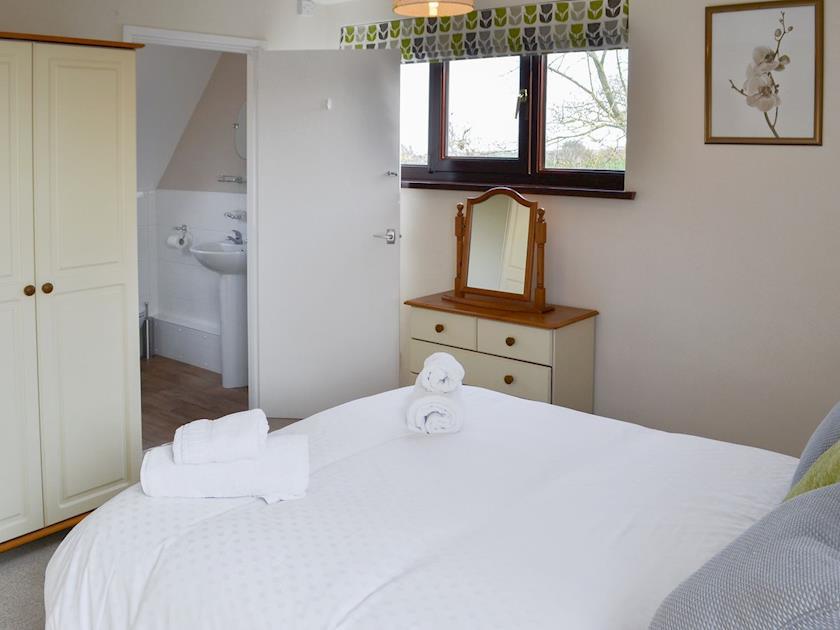 Comfortable double bedroom | Villa 55, Cromer