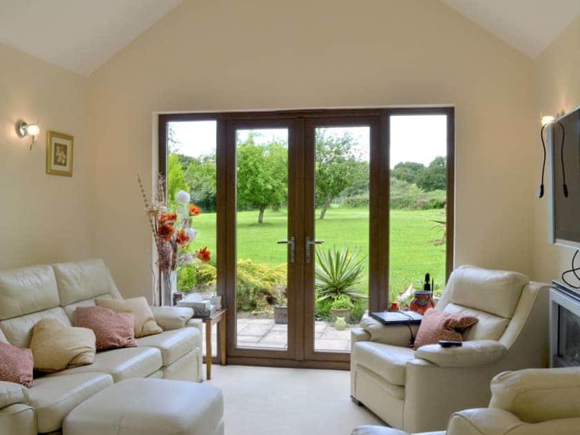 Light, airy, open plan living/dining room/kitchen | Moorland Lodge, Holt Wood, near Wimborne