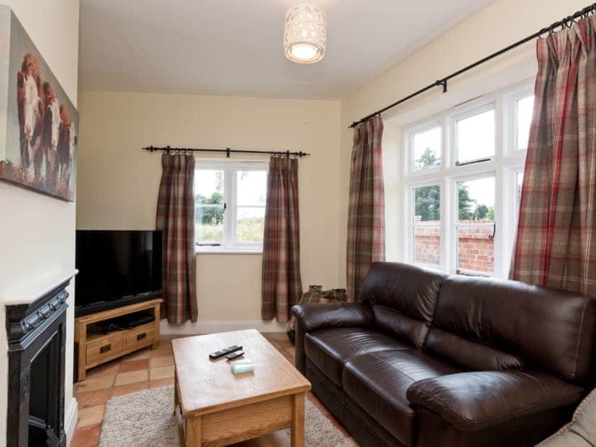 Lounge with TV | Three Horseshoes House, Scottow, near North Walsham