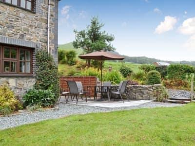 Garden & sitting area | Y Felin Barn, Llawryglyn, near Llanidloes