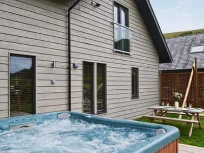 Hot tub   Lodge 3 - Mill Race Lodges, Llangunllo, near Knighton