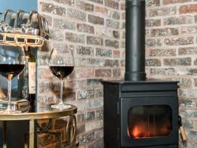 Wood burner | Kiri Cottage - Edenhall Estate, Edenhall, near Penrith