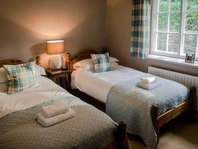 Cosy twin bedroom | Granton Lodge, Bowness-on-Windermere, near Windermere