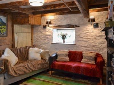 Characterful living/dining room with ornamental range fireplace   Strata Florida Cottage, Pontrhydfendigaid, near Tregaron