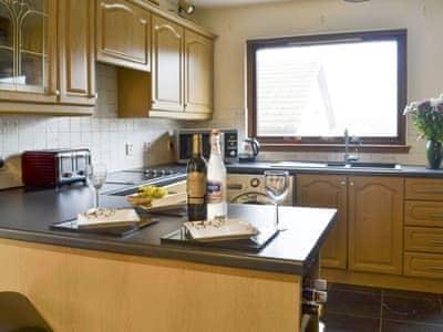 Spacious kitchen with breakfast bar | Sunart, Kiltarlity, near Beauly