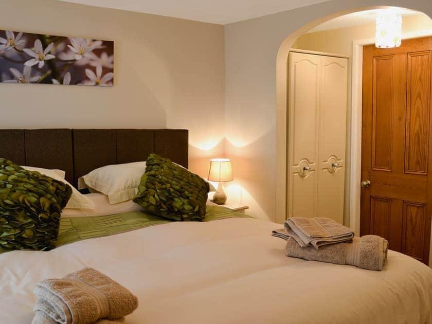 Bedroom with zip-and-link beds | April Cottage - Spring Cottages, Settle