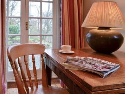 Living room with French doors | John Peel House, Ruthwaite, near Bassenthwaite