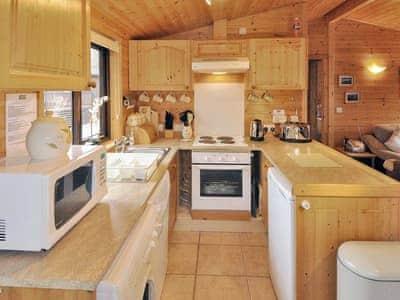 Compact galley style kitchen area | Derwent Lodge - Burnside Park - Burnside Park, Keswick