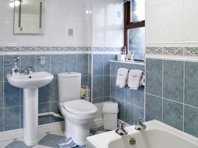Tiled bathroom |  Ysgubor - Beudy Hen and Ysgubor, Llanfair, near Harlech