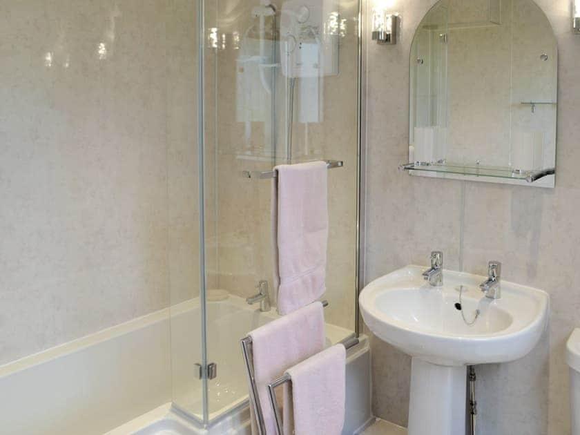 Family bathroom with shower over bath   Birch Cottage - Whitelee Farm, Bryness, near Otterburn