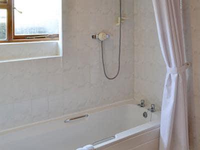Family bathroom with shower over bath | Bellypig Cottage, Bellerby near Leyburn