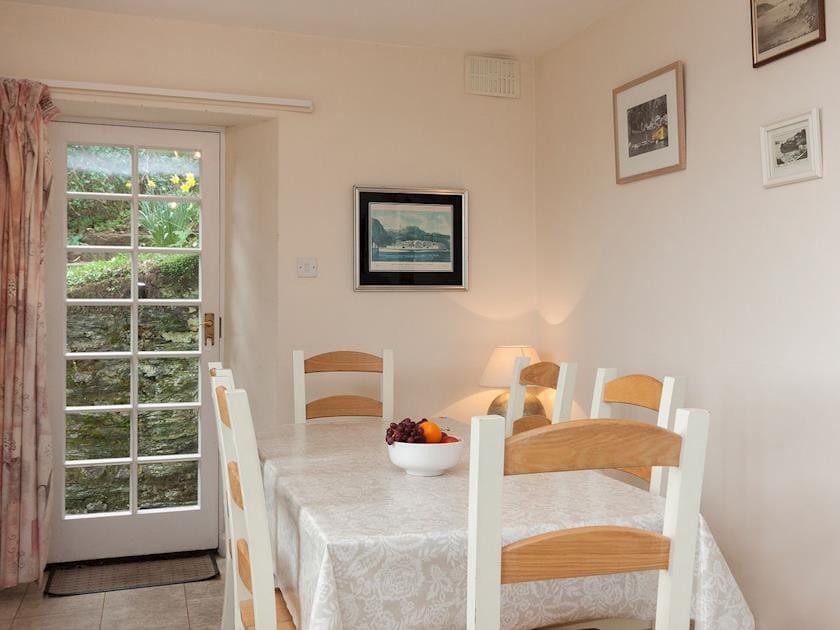 Attractive dining area with door to garden | Anchorage, Salcombe