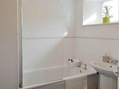 Family bathroom with shower over bath | Silvermoor Cottage, Denwick, near Alnwick