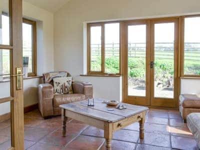 Comfy furniture in sunroom/living room   Solitude, Aberhafesp, near Newtown
