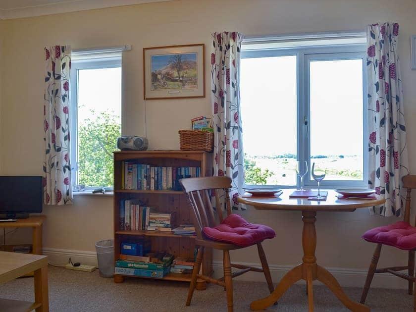 Modest dining area | Merlin House Holiday Apartments - Guinevere, Blue Anchor, near Minehead