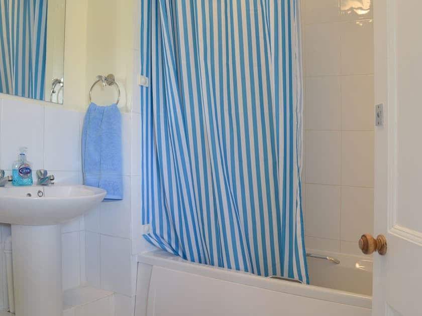 Bathroom with shower over the bath | Merlin House Holiday Apartments - Guinevere, Blue Anchor, near Minehead