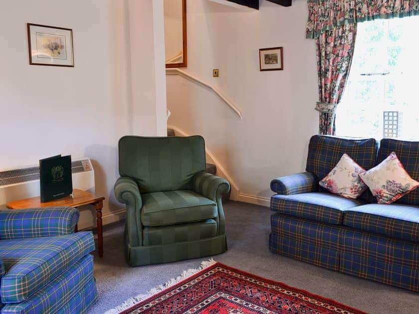 Living room with ornamental period range | Timberwick Green - Akeld Manor, Akeld, Wooler