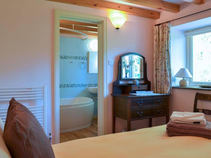 Beamed double bedroom with en-suite | Chapel Barn, Orton