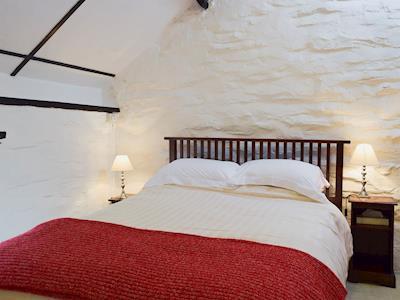 Comfortable bedroom with kingsize bed and beams | Y Teras, Rosebush, near Narberth