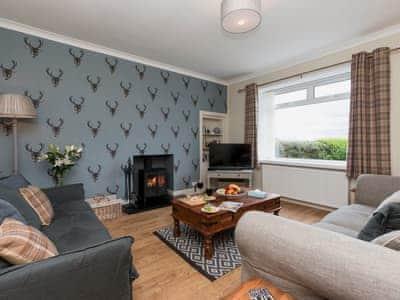 Comfortable living room with a wood burner   The Den at Culross, Culross, near Dunfermline