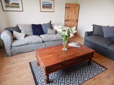 Comfortable living room with a wood burner | The Den at Culross, Culross, near Dunfermline