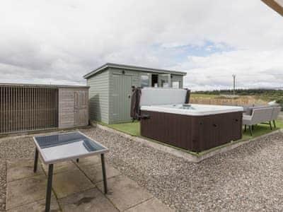 Enclosed rear courtyard with summerhouse, garden furniture, bbq andt hot tub | The Den at Culross, Culross, near Dunfermline