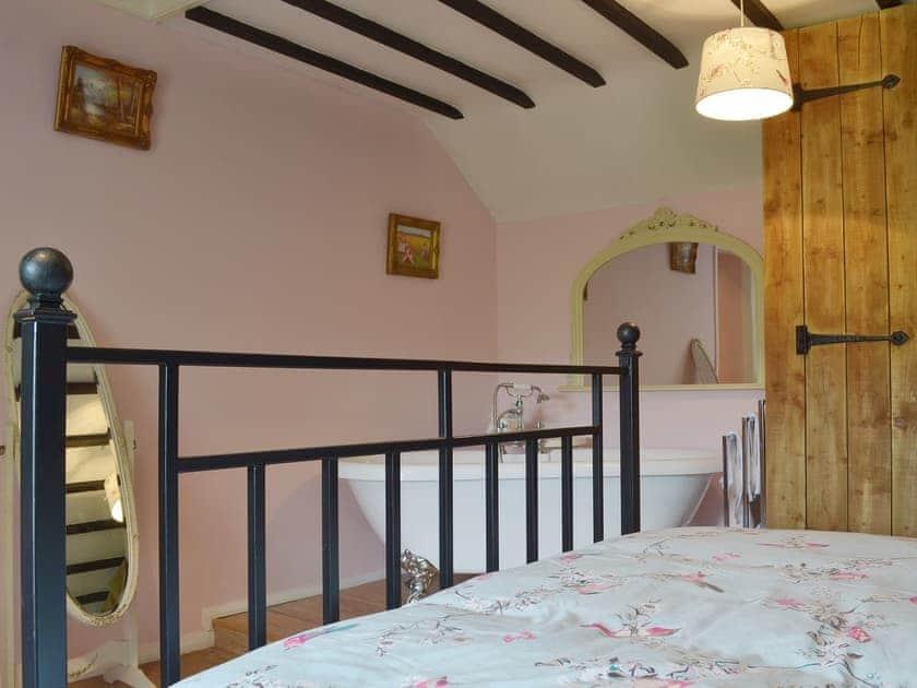 Beamed double bedroom with slipper bath   Holmefield Cottage - Holmefield, Darley Dale, near Matlock