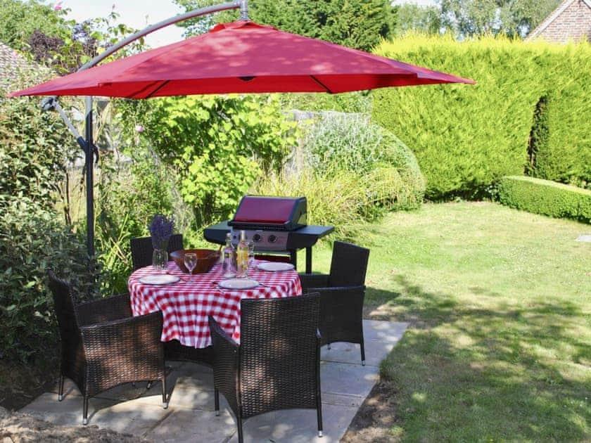 BBQ area in the garden | Cowbeech Farm Cottage, Cowbeech, near Hailsham