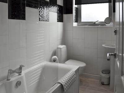Bathroom with shower over bath and heated shower rail | Alanna, near Scarborough