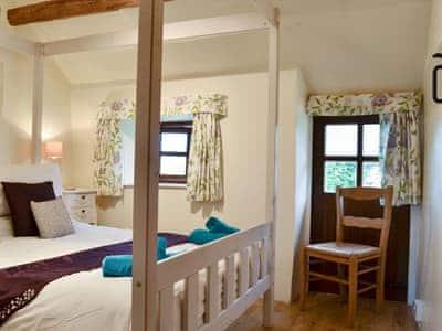 Delightful four poster bedroom | Ganny Cottage - Ganny Cottages, Birkerthwaite, Birkermoor
