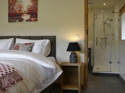 Thoughtfully furnished bedroom with en-suite | Wern Ddu Cottage, Penybontfawr, near Oswestry